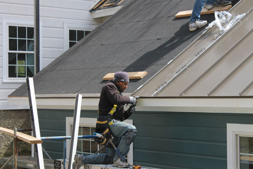 Our lead foreman Ayan Carcamo at work! - Installing a Painted 24 Gauge Steel Standing Seam Roof – Pine Plains, NY